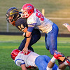 CHAD WEAVER | THE GOSHEN NEWS<br /> West Noble defensive lineman Draven Rasler sacks Fairfield quarterback Zac Lantz during the second quarter of Friday night's game at Fairfield. Also in on the play for West Noble is defensive lineman Chase Stoner,