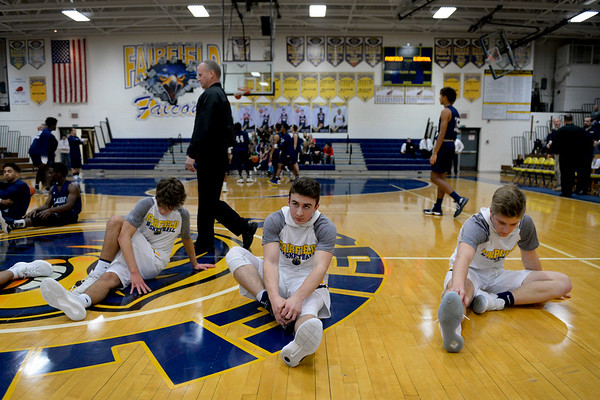 BEN MIKESELL | THE GOSHEN NEWS<br /> Members of the Fairfield Falcons stretch before their game Thursday against the Elkhart Central Blue Blazers in the 2017 Fairfield Holiday Tournament.