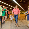 JAY YOUNG | THE GOSHEN NEWS<br /> Sixteen-year-old Ashton Rice, of Nappanee, exits the beef arena with her goat after being recognized as a grand champion during the parade of champions Thursday evening at the Elkhart County 4-H Fair.