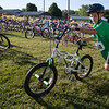 JAY YOUNG | THE GOSHEN NEWS<br /> Connor Olesen, of Etna Green, pushes his bicycle out of the transition area during 13th annual Kids' & Teens' Try-Athlon hosted by the Goshen Parks and Recreation Department at Shanklin Park Saturday morning.
