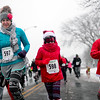 BEN MIKESELL | THE GOSHEN NEWS<br /> Danielle Carrington of Middlebury, left, runs with her son Drew, 8, in the Santa Run on Saturday in Elkhart. This was their first year participating in the race sponsored by The Michiana Pay It Forward Foundation.