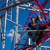 JAY YOUNG | THE GOSHEN NEWS<br /> Zachary Shue, 13, and McKenna Burks, 12, both of South Bend, take a ride on the roller coaster Friday evening at the Elkhart County 4-H Fair.