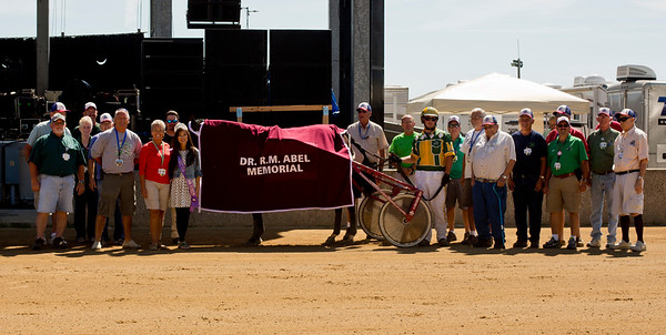 JAY YOUNG | THE GOSHEN NEWS<br /> Family and friends of Doc Abel honor him during a brief memorial service in between harness races Tuesday morning at the Elkhart County 4-H Fair.