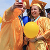 Roger Schneider   The Goshen News<br /> BreeAnn Cox snaps a selfie of herself and her friend Sheryl Brandenberger before they release balloons following the Fairfield graduation ceremony Sunday.