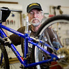 JAY YOUNG | THE GOSHEN NEWS<br /> Les Gustafson-Zook, of Goshen, looks over a bicycle in need of repair Wednesday morning at Chain Reaction Bicycle Project, 510 East Washington Street.