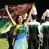 Scarlet Morgan's flag sails through the Concord Marching Minutemen during their exhibition performance at the 36th Annual Concord Invitational at Jake Field<br /> Saturday.
