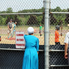 JULIE CROTHERS BEER | THE GOSHEN NEWS<br /> Spectators watch as children participate in the Home Run Derby event Tuesday in Nappanee. The event was part of the city's annual Independence Day celebration at Stauffer Park.