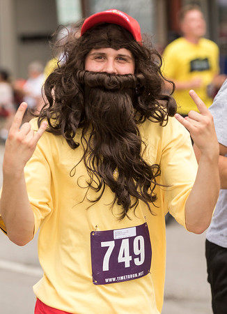 JAY YOUNG | THE GOSHEN NEWS<br /> Dressed as Forrest Gump, {749} hams it up in front of the camera while running in the annual Elkhart County 4-H Fair road race Sunday afternoon.
