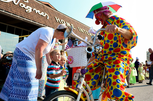 LEANDRA BEABOUT | THE GOSHEN NEWS<br /> Many children giggled and waved at Uncle Spokes, the cycling clown. Others weren't sure what to think.