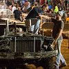 JAY YOUNG | THE GOSHEN NEWS<br /> Kane Johnson is helped out of his battered car after winning the featured heat of the demolition derby Saturday evening at the Elkhart County 4-H Fair.