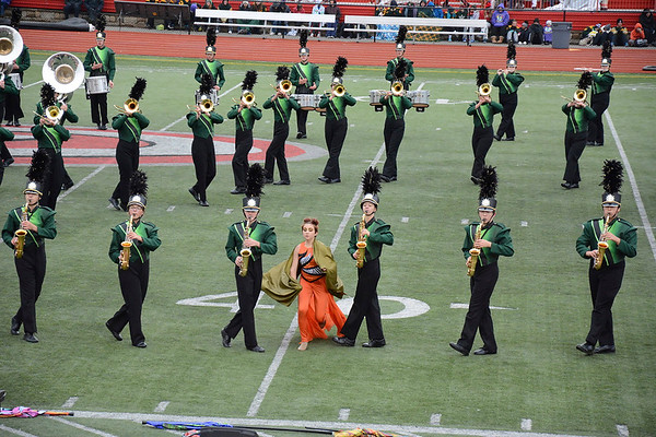 "Julie Maas | The Goshen News<br /> Members of the Raider Band of Northridge marches their show, titled ""Metamorphosis,"" at Pike High School during ISSMA Semi-State in Class B Saturday."