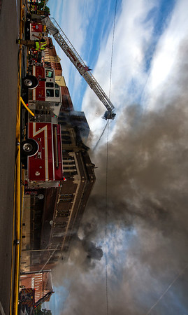 Jay Young | The Goshen News<br /> Smoke billows above a fire that destroyed buildings in downtown LaGrange Tuesday.