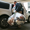 LEANDRA BEABOUT | THE GOSHEN NEWS<br /> Aaron Kobb, director of admin and finance at South Bend International Airport, unloaded bags full of teddy bears at Elkhart General Hospital.