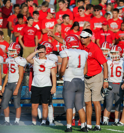 CHAD WEAVER | THE GOSHEN NEWS<br /> Goshen head coach Kyle Park has instructions for quarterback Austin Bontrager as he comes to the sideline during the first quarter of Friday night's game at Fairfield.