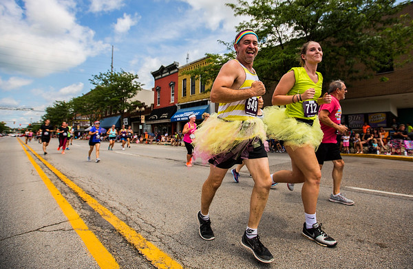 JAY YOUNG | THE GOSHEN NEWS<br /> Decked out in neon tutus, (549) and (712) have a little fun while running in the annual Elkhart County 4-H Fair road race Sunday afternoon.