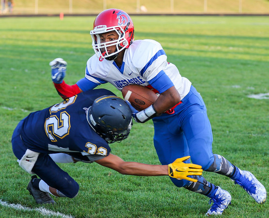 CHAD WEAVER | THE GOSHEN NEWS<br /> West Noble receiver Spencer Shrock tries to avoid the tackle by Fairfield defensive back Kaleb Rodriguez during the second quarter of Friday night's game at Fairfield.