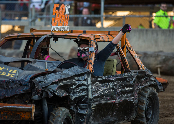 JAY YOUNG | THE GOSHEN NEWS<br /> Sabrina Johnson raises her arm after winning the compact heat during the demolition derby Saturday evening at the Elkhart County 4-H Fair.