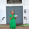 JOHN KLINE | THE GOSHEN NEWS <br /> Fair Board President Jill Garris gives her welcome address during a ribbon-cutting ceremony at the Sheep/Swine Arena early Friday morning officially launching the 2017 Elkhart County 4-H Fair. Garris chose the location due to the  large sign above the arena doors embossed with the 4-H Pledge. The sign is dedicated to her late father, Ralph Leatherman.