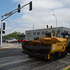 JAY YOUNG | THE GOSHEN NEWS<br /> City construction crews work to repave Second Street  south of Lincoln Avenue Monday morning as traffic backs up along Lincoln Ave.