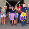 PHOTO SUBMITTED<br /> 4-H Dairy Grand Champion and Reserve Champion winners are pictured with buyers and supporters during the Elkhart County 4-H Dairy Auction Friday afternoon. Pictured in front, from left, are Hunter Mast, Reserve Champion Guernsey winner, Katlyn Rhoades, Grand Champion Guernsey winner, Dillion Weldy, Reserve Champion Brown Swiss winner; Ryan Blosser, Grand Champion Ayrshire winner; and Joshua Yoder, Reserve Champion Jersey winner. Pictured in back, from left, are friends and family of Hunter Mast, Friends and family of Katlyn Rhoades, Friends and family of Dillion Weldy, Friends and family of Ryan Blosser, Dr. Robert Zell, and Friends and family of Joshua Yoder.