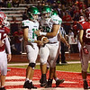 JAY YOUNG | THE GOSHEN NEWS<br /> Concord High School  senior lineman Zech Garza (78) congratulates senior running back Jack Lietzan (14) after Lietzan scored a touchdown while Goshen High School players watch during their game Friday night at GHS.