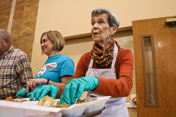 LEANDRA BEABOUT | THE GOSHEN NEWS<br /> Loretta Reynolds of Goshen asks a visitor if she wants more food at First United Methodist Church.