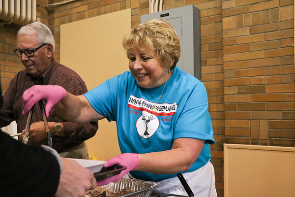 LEANDRA BEABOUT | THE GOSHEN NEWS<br /> Sally Stutsman of Goshen helped serve turkey at First United Methodist Church.