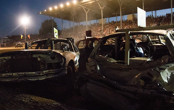 JAY YOUNG | THE GOSHEN NEWS<br /> Cars get stuck on the log barrier during the demolition derby Saturday evening at the Elkhart County 4-H Fair.