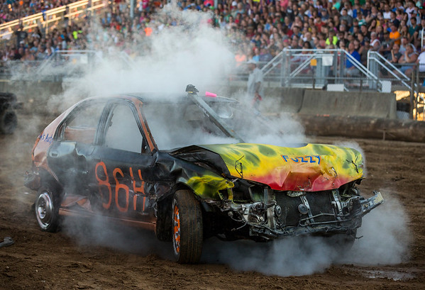JAY YOUNG | THE GOSHEN NEWS<br /> A car in the compact heat fills with smoke during the demolition derby Saturday evening at the Elkhart County 4-H Fair.