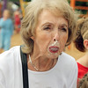 ADAM RANDALL | THE GOSHEN NEWS<br /> Marcia Middlebrooks, Topeka, tries to blow a bubble during a gum chewing contest in Topeka Tuesday.