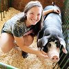 ADAM RANDALL | THE GOSHEN NEWS<br /> Marissa Rasler, 16, Nappanee, and one of her three pigs that she is showing this year at the fair.