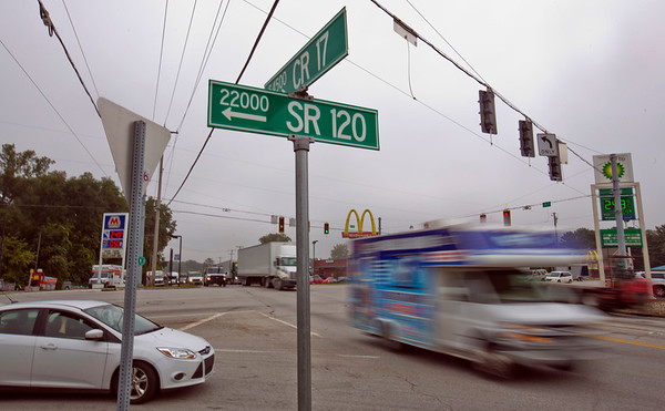 JAY YOUNG | THE GOSHEN NEWS<br /> A car waits to make a right turn onto C.R. 17 as a truck goes speeding by Thursday morning at the intersection of C.R. 17 and S.R. 120 in Elkhart.