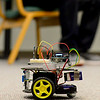 BEN MIKESELL | THE GOSHEN NEWS<br /> The mind controlled robot created by Goshen College junior Alex Steiner and sophomore Ryan Haggerty won Best of Show on Monday at Goshen College's 2017 Electronics & Robotics Show. Steiner and Haggerty spent the morning presenting their end-of-semester project to students and faculty, and let them wear the headband apparatus that controls the robot.