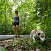 JAY YOUNG | THE GOSHEN NEWS<br /> Nancy Brock and Danny, her Jack Russell mix, walk along a shaded road in Oxbow Park Wednesday afternoon. [LASTNAME] said she usually comes to the park a couple of times to day.