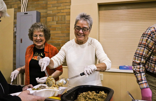 LEANDRA BEABOUT | THE GOSHEN NEWS<br /> Eva Hooley, Goshen, and Jane Klonowski, Middlebury, work together to serve Thanksgiving dinner.