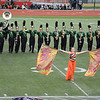 Julie Maas | The Goshen News<br /> Emily Hamilton, color guard, leads the Northridge Raiders as they march toward the stands at Pike High School Saturday.