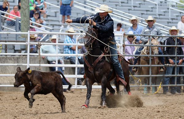 JAY YOUNG   THE GOSHEN NEWS<br /> Cord Barricklow, of Lebanon, chases down a calf during the calf roping event Friday afternoon rodeo at the Elkhart County 4-H Fair.