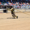 CHRISTINA CLARK | THE GOSHEN NEWS Steffen Schrock, of Goshen Fire Department, and Firefighter Challenge Winner, carries charged hose line, about 75 pounds, to knock down a target.