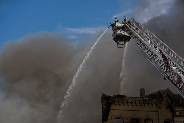 JAY YOUNG | THE GOSHEN NEWS<br /> Water rains down as firefighters battle a large fire in downtown LaGrange Tuesday afternoon.