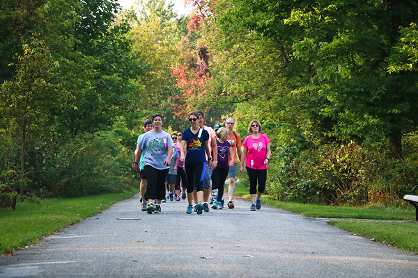 LEANDRA BEABOUT | THE GOSHEN NEWS<br /> A group of walkers for the Maple City Walk 10k rounds the bend into Abshire Park.