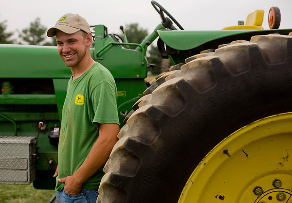 JAY YOUNG | THE GOSHEN NEWS<br /> Ben Sheets, of Nappanee, next to his John Deere 4320 Thursday morning during the tractor pull competition at the Elkhart County 4-H Fair.