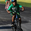 JAY YOUNG | THE GOSHEN NEWS<br /> Kortney Malone, of Goshen, focuses his attention forward as he races down the 1.2 mile cycling course during the 13th annual Kids' & Teens' Try-Athlon hosted by the Goshen Parks and Recreation Department at Shanklin Park Saturday morning.