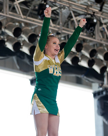 JAY YOUNG | THE GOSHEN NEWS<br /> A member of the Wawasee High cheer squad is raised high in the air while she performs during the 44th annual cheerleading contest that is part of the Elkhart County 4-H Fair Friday afternoon. Three cheer squads took part in the competitive portion of the event, with Concord taking first place, Wawasee High taking second place and Oregon-Davis High placing third. John Adams High was also on hand as the only squad competing in the spirit squad portion of the event. Other activities included a jump off and demonstrations by Indiana Ultimate.