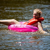 JAY YOUNG   THE GOSHEN NEWS<br /> Francesca Carlen, of Elkhart, lays back and relaxes as she slowly floats down the Elkhart River during the Rhapsody in Green Music Festival at Island and Bicentennial Parks in Elkhart.