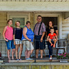 JAY YOUNG | THE GOSHEN NEWS<br /> The Yontz family, named this year's Elkhart County 4-H Fair family of the year is pictured on the front porch of their family home that goes back at least four generations. From left are Sara Yontz, Jayme Yontz, Mary Yontz, Rick Yontz, Paola Miller and Greylynn Miller, 2, (seated).