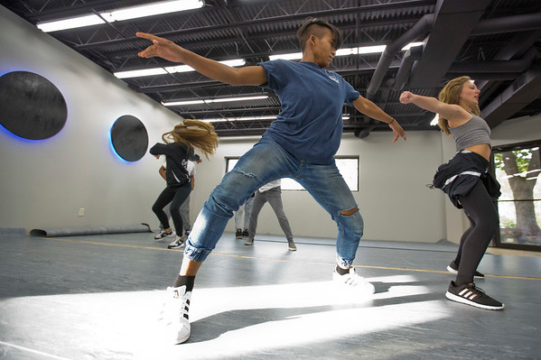 JAY YOUNG   THE GOSHEN NEWS<br /> Darin Dim, left, and Annaleah Freeze show off their moves during a hip hop dance class Wednesday evening at Epic Dance Studios.