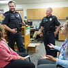 JAY YOUNG | THE GOSHEN NEWS<br /> Concord police officers Nic Minder, left, and Darrin Tucker, chat with student office workers during fifth hour Thursday afternoon at Concord High School. The Concord School District recently incorporated a new police department.