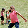 SHERRY VAN ARSDALL | THE GOSHEN NEWS<br /> Cellia Salazar, 8, Dunlap, throws a atlatl spear during the 50th celebration of Elkhart County Parks at Ox Bow County Park in Dunlap Sunday afternoon.