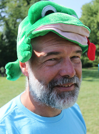 Roger Schneider | The Goshen News<br /> Middlebury Parks Director Tom Enright wears a frog hat to promote the amphibian theme for the Middlebury Riverfest that was held Saturday at River Bend Park.