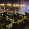 JAY YOUNG | THE GOSHEN NEWS<br /> Harrison firefighters get a front row seat at the demolition derby Saturday evening at the Elkhart County 4-H Fair.